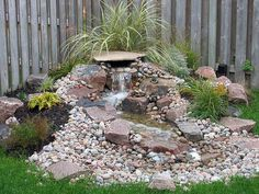I want a water feature of some sort in the backyard - for now, with the little kids, something either pond-less or with very shallow pond would be best (someday it will be back to something large enough for a few fish) (BTW, this one is not very well exe Backyard Water Feature, Ponds Backyard, Outdoor Waterfalls, Garden Waterfall, Fish Ponds, Water Garden, Backyard Landscaping, Landscaping Ideas, Water Features