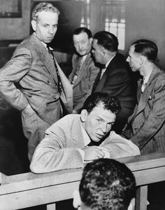 Frank Sinatra and columnist Lee Mortimer appear in court in 1947 after an altercation at Ciro's nightclub where Sinatra punched Mortimer. Sinatra claimed that Mortimer, who had repeatedly bashed Sinatra in his column, used a racial slur against Sinatra which provoked him. The two eventually reached a settlement of $9,000. This was one of several events that sent Sinatra's career downhill, where it would remain until 1953.