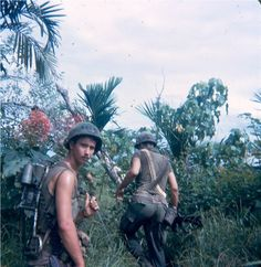 RTO and another soldier of the 196th LIB. The radio telephone operator carries a PRC-25 radio with the antenna held over his left shoulder.