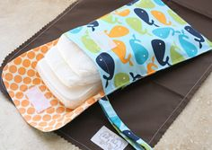 Adorable!!   Blue Whales Change 'N Go Diaper Set from Dilly Baby; 10% of all orders on Dilly Baby's website are donated to Autism Speaks http://www.dillybaby.com/collections/frontpage/products/blue-whales-change-n-go-diaper-set
