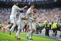 Real Madrid players celebrate after earning a 3-1 win against Barcelona in El Clasico...