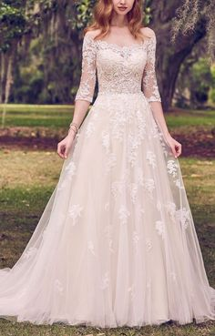 Maggie Sottero - BREE, Romantic lace motifs cascade over tulle in this illusion, off-the-shoulder, A-line wedding dress. Lace motifs complete the illusion portrait neckline, illusion half-sleeves, and illusion back. #vintageweddingdress #classicweddingdress