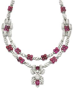 Ruby and diamond necklace, 1930s. Of geometric design decorated with oval rubies, circular-cut and baguette diamonds, accented with a pair of plaques of ribbon design and a pendant, length approximately 560mm, French assay and partial maker's marks, detachable into eight sections.