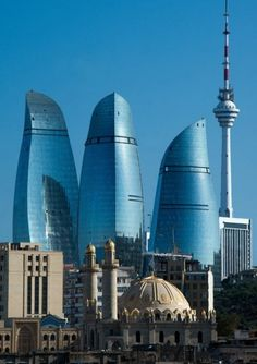 he commercial and residential Flame Towers, designed by Zaha Hadid, have become identifiable across the world as a defining feature of the Baku skyline. The influence of traditional architectural influences is also evident within the design. New Architecture, Futuristic Architecture, Beautiful Architecture, Baku City, New Flame, Tower Light, Amazing Buildings, Man Ray, Building Design