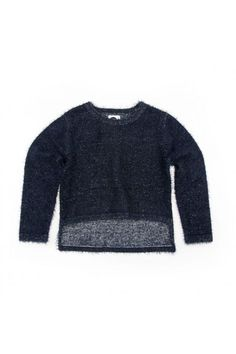 Fuzzy cropped cotton jumper featuring split hem and super soft texture. 100% Cotton Available in Indigo and Lipstick.