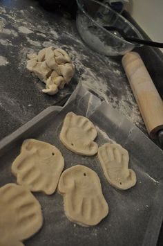 Detailed instructions on salt dough ornaments.  Hand print can be made into a santa.