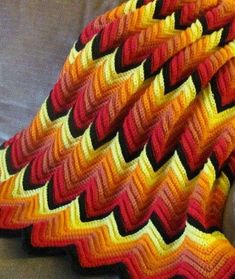 Hand Crochet afgan Flame on by Noelsembellishments on EtsyItems similar to Hand Crochet Afgan.Comes to you special orderd in about 2 weeks on EtsyFlames Crochet Zig Zag Blanket - My mom and I made one of these. It was pinks and maroon. Very pretty. Zig Zag Crochet, Crochet Ripple Blanket, Crochet Bedspread, Afghan Crochet Patterns, Single Crochet, Hand Crochet, Crochet Stitches, Free Crochet, Knit Crochet