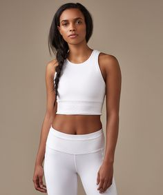 From treadmill to track, we  designed this cropped tank to  pair with to your favourite  high-rise bottoms.