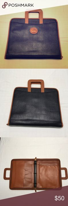 """Dooney & Burke briefcase Navy pebbled leather with brown trim and interior leather. Features 3 ring binder, notepad holder, pen loop, 3 cards slots and pleated pocket. Zip closure and collapsible handles that slide ink outer front and back pockets. Small stain below zipper as shown in last pic. Not that noticeable when in use. 14"""" wide, height approx. 11"""", depth 2.25"""" Dooney & Bourke Bags"""