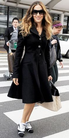 SJP rocks black and white Saddle Shoes.