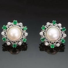 Vintage clip earrings pearls emeralds diamonds. $7,500.00, via Etsy.