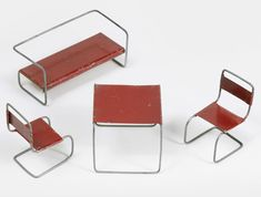 Bauhaus Furniture Set | Germany, 1930s 4.5 x 2 x 2 |Miniature bent metal seating set in the style of Marcel Breuer. The sofa, pair of chairs, and table all retain their original patina.