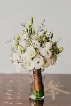 Wedding bouquet of white eustomas // KS and Avis' Mountain Garden Nuptials at Tanarimba Janda Baik