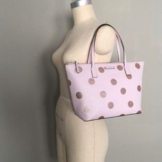 """Kate Spade New York Pink Polka Dot Hani Haven Lane Tote  ★ Size: Medium ★ Color: Pink ★ Condition: Like-New   Item Details: ★ Brand: Kate Spade New York ★ Item Name : Pink Polka Dot Hani Haven Lane Tote ★ Main Style: Pink Crosshatched Vinyl with Glittered Polka Dots ★ Manufacture Color: Pink ★ Exterior: Leather/PVC ★ Interior: Myriad Pockets: One Zip + Two Slip ★ Compartments:  ★ Lining: Name Embossed Fabric ★ Closure: Zip-Top ★ Drop Length: 6"""" ★ Dimensions: 14""""W x 9""""H x 5""""D ★ Features: Playfull Kate Spade Totes, Kate Spade Tote Bag, Kate Spade Pink, Embossed Fabric, Pink Tote Bags, Hani, Pink Polka Dots, Fashion Bags, Leather"""