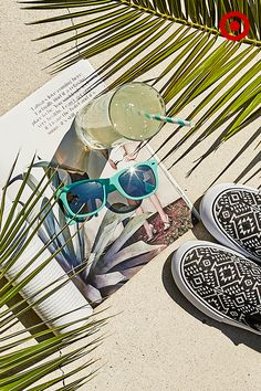 If you're planning on doing some poolside reading this summer, settle in with a favorite magazine, a cool drink, colorful sunglasses and some slip-on sneakers.