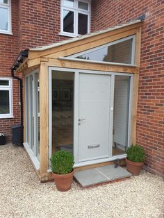 Our bespoke wooden front & entrance doors are available in a range of stunning colours & contemporary funky designs. Porch Timber, Glass Porch, Porch Extension, House With Porch, Entrance Porch, House Extension Design, Wooden Porch, Garden Room Extensions, Porch Design