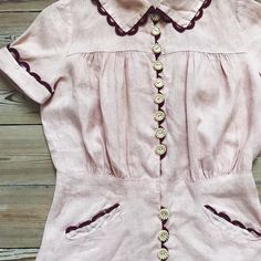 """{ Sold } 1930s summer linen blouse in pale pink with the cutest burgundy trim to make the button holes! Very good condition, only needs a soak. Approx a size XS-S. Bust 19"""", waist 14"""", shoulders 13"""", length from shoulder to hem 21"""". Dm for more info!"""