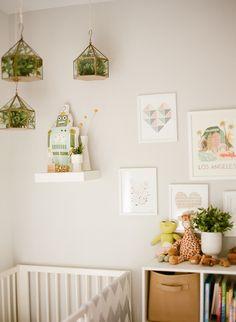 Fresh nursery with terrariums and art prints