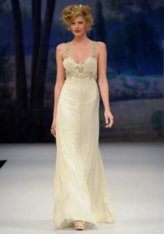 JOLIE    Spring 2012  Gold silk chiffon cross back sheath with rose gold guipure straps and floral embellishment