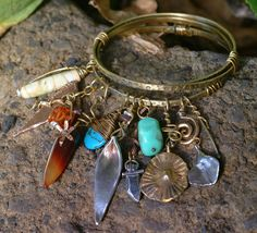 Possible diy: three metal bangles, wired together and a lot of misc beads/charms Gypsy's Purse Bangle Bracelet