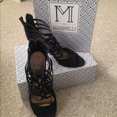M by Marinelli Black Heels These heels are black, size 9M. The ball of the shoes are a little worn, but the shoes are in great condition otherwise. M by Marinelli Shoes Heels
