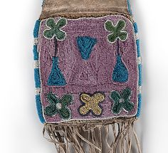 Northern Plains Beaded Hide Tobacco Bag From the Collection of Jan Sorgenfrei, Ohio.  thread and sinew-sewn hide beaded using colors of pony trader blue, white, red white-heart, greasy yellow, pink, white, pumpkin, and dark blue; elongated throat is enhanced along one side with a lane of pony trader blue beads, overall length 27 in. late 19th century.  ДА3. Cowan's 08 апреля 2017.