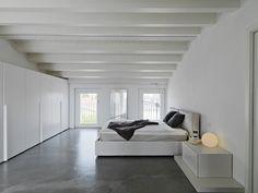Concrete floor in minimalist modern bedroom. Loft style. @ToscaSurfaces #loverenovation #decorideas