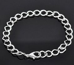 Silver tone curb chain bracelet in zinc alloy, the perfect base for your next jewelry creation!Total length: thickness: size: outer - x inner x clasp: outer - x inner x ring: OD - ID - will receive 12 bracelets.All of our products are lead and ca Silver Bracelets, Bangle Bracelets, Silver Cuff, Sterling Silver, Link Bracelets, Clip On Charms, Metal Beads, Silver Charms, Anklet