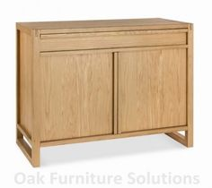 Studio Oak Narrow Sideboard with hidden drawer combines style with functionality with a minimalist and retro touch.With a clean lacquered finish and two well-proportioned cupboards this would be the ideal addition to a living or dining room.  £339.99