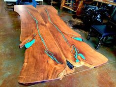 Custom Made Mesquite Wood Live Edge Slab Base with Turquoise Inlay. Showcasing unrefined features and made with natural form slabs of solid mesquite wood.