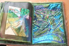 Fabrick Art journal for my postcards ,The cover of the journal is a cotton fabric on top of it silk and wol felted ,Machine embriodeerd on top of that ...