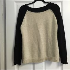 Brandy Melville thick black and cream knit sweater Randy Melville thick knit sweater with a cream body and black arms and lining Brandy Melville Sweaters