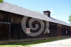 Photo about This is a old historic horse barn from early century restored and on display at the Shelburne museum in Vermont. Image of doors, shelburne, barn - 74302251