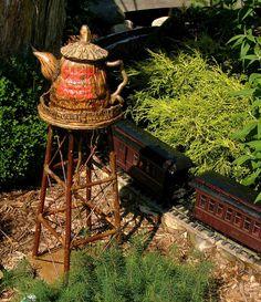 rustic teapot silo for railroad garden at Fernwood Botanical Gardens. from my photo collection. #pinteatuesday Mini Fairy Garden, Love Garden, Garden Train, Fairy Gardens, Rustic Gardens, Outdoor Gardens, Model Trains, Toy Trains, Garden Railings