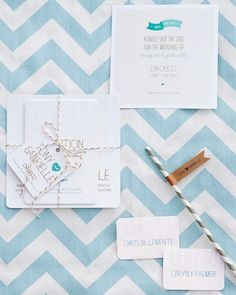 """""""Since we are both designers, it was only natural for us to take on the design of the invites,"""" Gabrielle said. The couple started by gathering lots of inspiration, then set out to create a multi-layered invitation that was both casual and simple. Many of the elements -- the typography, trailing vines, and color palette -- were carried through to the day-of paper elements, including the menus at the dessert and wine stations, the escort cards, and the place settings."""