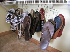 organize your shoes with wire hangers!