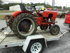 Power King Economy tractor 18 hp. This tractor has three point hitch and a belly mower. The engine needs work, I think a new cam.