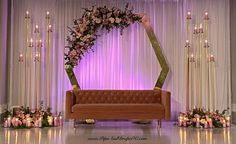 Simple white sheer drapes are a great backdrop for this Gold octagon and large candelabras. WE love this retro couch too! Reception Decorations, Event Decor, Retro Couch, Wedding Draping, Indian Engagement, Pipe And Drape, Sheer Drapes, Ethnic Wedding, Sweetheart Table