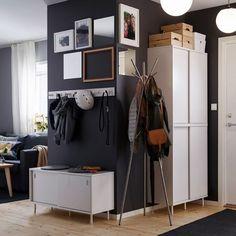 Ikea hallway storage a dark grey open hallway with white storage units and coat hooks ikea Storage Compartments, White Storage, Hallway Storage, Ikea, Ikea Hallway, Bench With Storage, Hallway Designs, Storage, Storage Unit