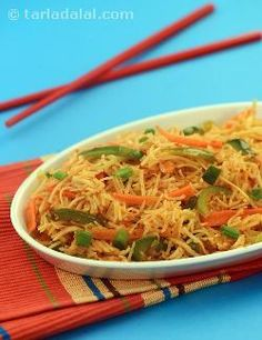 Triple Schezuan Rice, a wholesome combination of sauteed vegetables, noodles and rice tossed in schezuan sauce.