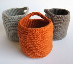 Oh my gosh... this is exactly what I need... I'm going to make one in a different color for each kid, hang them from coat hooks and use them for hats, gloves and winter paraphernalia. crocheted storage bins. practical and pretty. (Idea only -- no pattern at link)