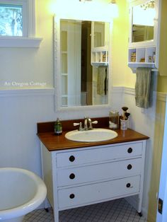 How to make a dresser into a vanity with photos of the steps needed including ideas for adapting drawers.