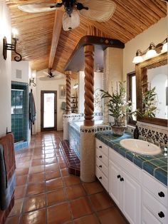 Cabana inspired guest bathroom featuring hand carved wood columns and hand glazed and fired tiles. Spanish Style Bathrooms, Spanish Bathroom, Spanish Style Homes, Spanish Bungalow, Spanish Revival, Spanish Colonial, Pergola, Wood Columns, Tropical Bathroom