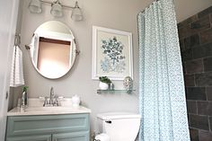 """Once I saw the Allen + Roth shower curtain, I knew. We were gonna go with the feminine turquoisey blue. Based on that, I was able to choose paint – a neutral """"Marble Tile"""" for the walls and """"Park Place"""" to pop the vanity (both Allen + Roth shades)"""