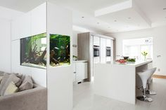Modern White Gloss & Driftwood Kitchen with Fish Tank contemporary kitchen