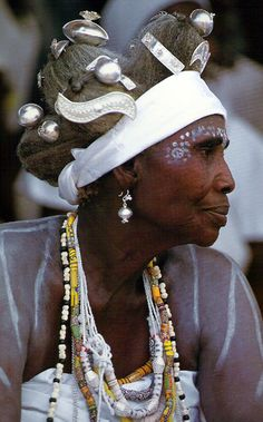 Africa | Fante Priestess wearing the white wrappers and body chalk associated with her vocation. Her hair is fashioned in a dramatic style. Ghana | ©Carol Beckwith and Angela Fisher ~ African Ceremonies, Vol 2, 1999