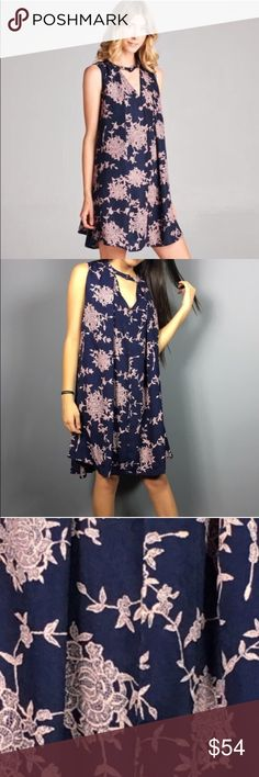 🆕Beautiful purple trapeze dress 💕 Gorgeous floral print dress. Dark blue and pink colors. Made out of polyester and rayon materials. Soft woven v-neck with button enclosure accents. Drapes very nicely and feels very luxurious on ones skin. Can be worn as a tunic with cute jeans on or throw on some wedges for a night out💜 Dorimas Closet Dresses Midi
