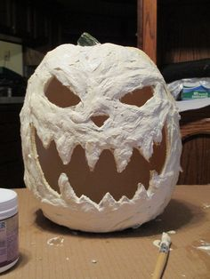 A craft store foam pumpkin gets extra scary with a coat of latex and cotton. The creator went on to paint this guy orange, but I like him ghostly white.