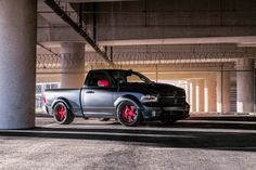 "What do you get, when you mate a supercar with a pickup truck? Dallas Speed Shop's ""Hellfire"" Dodge Ram 1500 is powered by a 775HP supercharged 6.2L Hellcat V8 equipped with Kooks headers and exhaust and rides on giant Rotora carbon-ceramic brakes, and 22x11.5 Forgeline FF3 wheels finished with Transparent Red centers and Black Pearl outers! See more at: http://www.forgeline.com/customer_gallery_view.php?cvk=1781  Photos by Pepper Yandell Photography #Ram1500 #pickup #Forgeline"