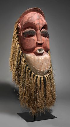 Africa   Helmet mask from the Suku people of DR Congo   Wood, raffia, brass tacks, animal hair, resin and pigment   ca. early 20th century